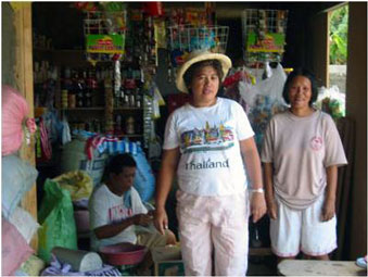 Elsa Belarmino in the store at the rice mill